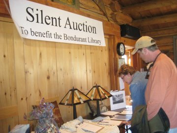 Browsers examine a few of the Silent Auction items