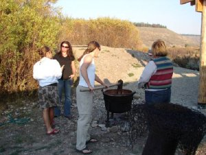 Ladies stirring the apple butter pot for 8 hours